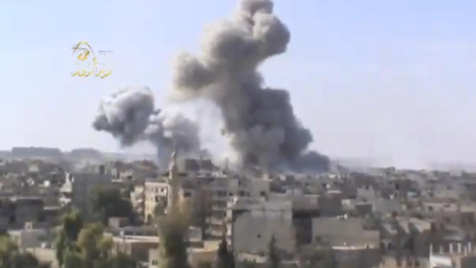 This image taken from video obtained from the Ugarit news network, which has been authenticated based on its contents and other AP reporting, shows smoke rising from the city following heavy bombing from military warplanes, in Deir el-Zour's  Jbeileh neighborhood, 450 km northeast of Damascus Syria, on Monday  Oct. 29, 2012. Syrian warplanes launched 60 airstrikes against rebel targets around the country on Monday, the most intense air raids across the country since the uprising began 19 months ago, according to anti-regime activists. Activists said at least 500 people were killed over the four-day period ending Monday when a U.N.-backed truce was supposed to be in effect. They said the death toll for Monday so far has reached 80.(AP Photo/Shaam News Network via AP video)
