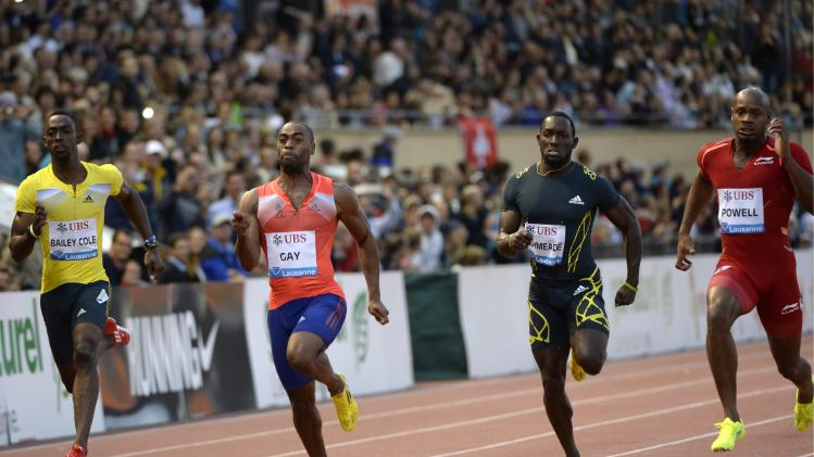 From left, Kemar Bailey Cole, from Jamaica, Tyson Gay, from the US, Nickel Ashmeade, from Jamaica, and Asafa Powell, from Jamaica, cross the finish line of the men's 100m race, at the Athletissima IAAF Diamond League athletics meeting, in the Stade Olympique de la Pontaise in Lausanne, Switzerland, on Thursday, July 4, 2013. (AP Photo, Keystone, Jean-Christophe Bott)