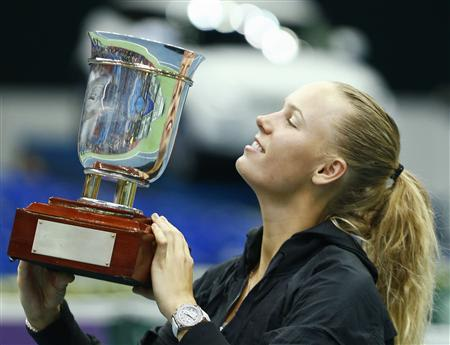 Denmark's Wozniacki holds her trophy after defeating Australia's Stosur in the women's singles final at the Kremlin cup tennis tournament in Moscow