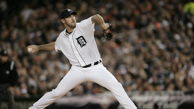 Detroit Tigers starting pitcher Justin Verlander throws during the first inning of Game 3 of baseball's American League division series against the New York Yankees on Monday, Oct. 3, 2011, in Detroit. (AP Photo/Duane Burleson)