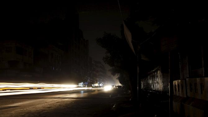 Vehicles cause light streaks during a major power breakdown, in Karachi,