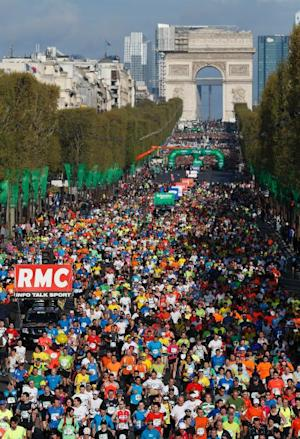 Competitors run on the Champs Elysees at the start…