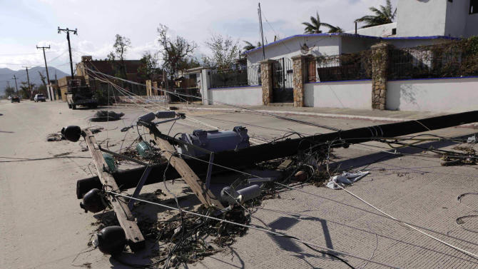 Knocked-down power lines are seen on the street in San Jose del Cabo, after Hurricane Odile hit in Baja California
