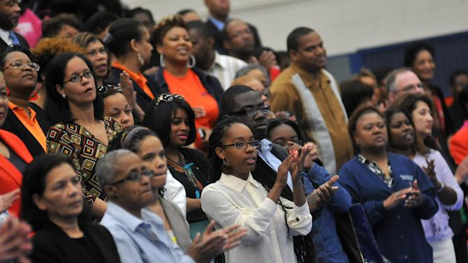 """Audience members applaud during a memorial service at Virginia State University in Chesterfield County, Va. Friday, April 26, 2013 for two students, Jauwan Holmes and Marvell Edmondson, who drowned in the nearby Appomattox River on April 20. Edmonson of Portsmouth and Holmes of Newport News were swept away by the rapids of the Appomattox during what police have described as part of an initiation involving the group """"Men of Honor."""" Four men affiliated with the group have been charged with hazing.  VSU has said the little-known group is not sanctioned by VSU. (AP Photo/The Progress-Index, Patrick Kane)"""