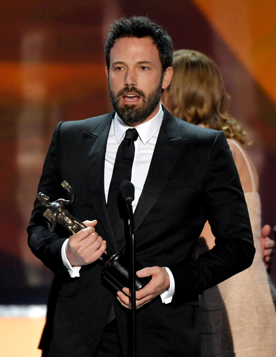 "Ben Affleck accepts the award for outstanding cast in a motion picture for ""Argo"" at the 19th Annual Screen Actors Guild Awards at the Shrine Auditorium in Los Angeles on Sunday Jan. 27, 2013. (Photo by John Shearer/Invision/AP)"