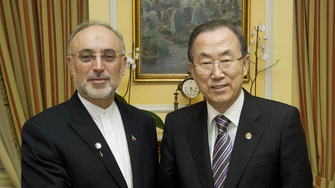 In this photo provided by the United Nations, Iranian Foreign Minister Ali Akbar Salehi, left, poses with United Nations Secretary General Ban Ki-moon at the Sacher Hotel in Vienna, Austria, Wednesday, Feb. 27, 2013. (AP Photo/The United Nations, Evan Schneider)