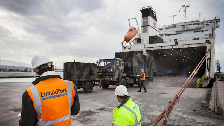 In this photo released by the Audio Visual Department of the Dutch Defense Ministry, Dutch military trucks carrying NATO's Patriot Missile Defense System to protect Turkey in case neighboring Syria launches an attack, are being unloaded in the port in the Mediterranean city of Iskenderun, Turkey, Tuesday, Jan. 22, 2013. The Dutch Patriot Systems and troops were heading for Adana to prepare to operate a defensive missile system close to the border with Syria. (AP Photo / Rob van Eerden, Dutch Defense Ministry, HO)