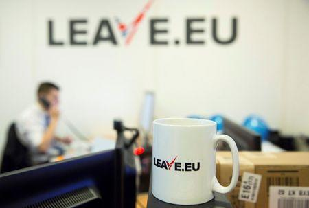 "A worker answers a telephone in the office of Brexit group pressure group ""Leave.eu"" in London, Britain"