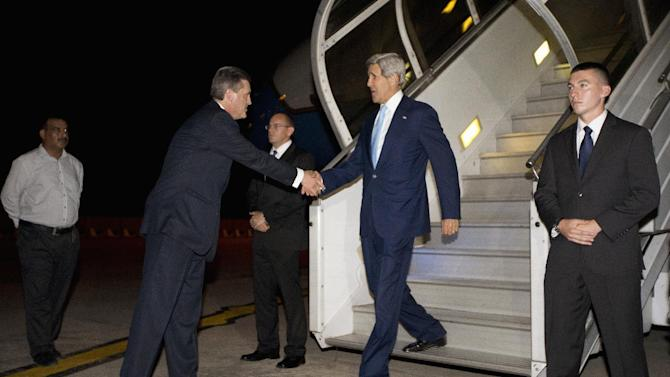 Secretary of State John Kerry is greeted by U.S. Ambassador to Pakistan Richard Olson upon his arrival in Islamabad, Pakistan, Wednesday, July 31, 2013. Kerry is scheduled to meet with members of Pakistan's newly-elected civilian government on Thursday. (AP Photo/Jason Reed, Pool)