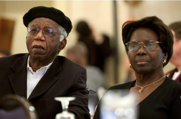 This 2010 photo provided by Brown University shows Chinua Achebe, left, with his wife Christie Achebe on campus in Providence, R.I. Achebe, an internationally celebrated Nigerian author, statesman and
