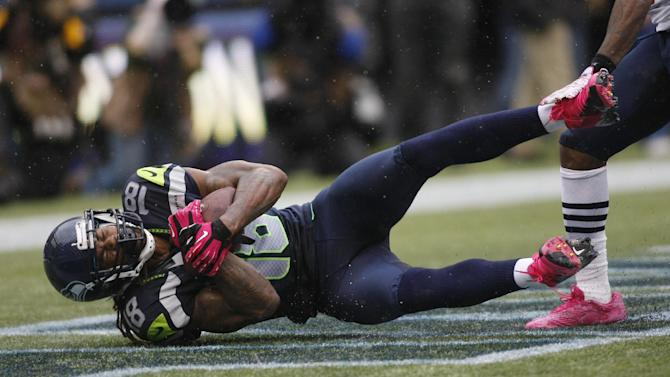 Seattle Seahawks' Sidney Rice comes down with a game-winning touchdown reception in the second half of an NFL football game against the New England Patriots, Sunday, Oct. 14, 2012, in Seattle. The Seahawks beat the Patriots, 24-23. (AP Photo/John Froschauer)