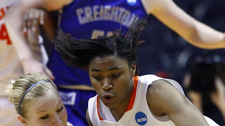 Syracuse guard Cornelia Fondren, right, battles for the ball with Creighton guard McKenzie Fujan during the first half of a first-round game in the women's NCAA college basketball tournament on Saturday, March 23, 2013, in Knoxville, Tenn. (AP Photo/Wade Payne)