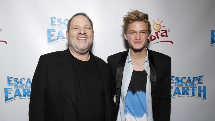 "Harvey Weinstein and Cody Simpson attend the LA premiere of ""Escape from Planet Earth"" at the Chinese Theater on Saturday, Feb. 2,2013 in Hollywood. (Photo by Todd Williamson/Invision/AP Images)"