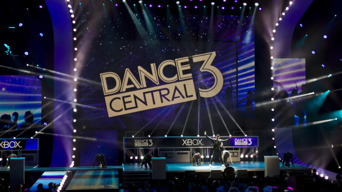 Singer Usher, right, performs during the introduction of the Xbox 360 music video game 'Dance Central Three' for the Xbox 360 with Kinect, at the Microsoft Xbox E3 2012 media briefing in Los Angeles Monday, June 4, 2012. The 2012 E3 Electronic Entertainment Expo runs from June 5-7 in Los Angeles. (AP Photo/Damian Dovarganes)