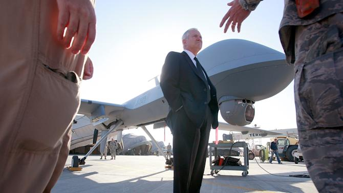 FILE - In this Dec. 11, 2008 file photo Defense Secretary Robert Gates stands by an unmanned aerial vehicle (UAV) at Kandahar Air Field in Kandahar, Afghanistan. Gates, a former defense secretary and spy chief, is backing lawmakers' proposal to form a special court to review President Barack Obama's deadly drone strikes against Americans linked to al-Qaida. Gates said Obama's use of the unmanned and lethal drones follows tight rules, but he shares lawmakers' wariness over using drones to target al-Qaida operatives and allies from the sky. (AP Photo/Scott Olson, Pool)