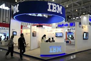 Visitors walk past the IBM booth at the 9th China International Software Product & Information Service Expo in Nanjing