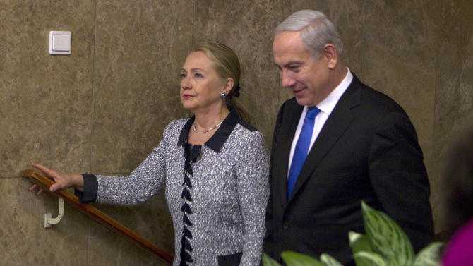 """Israel's Prime Minister Benjamin Netanyahu walks with U.S. Secretary of State Hillary Rodham Clinton upon her arrival to their meeting in Jerusalem, Tuesday, Nov. 20, 2012. A diplomatic push to end Israel's nearly weeklong offensive in the Gaza Strip gained momentum Tuesday, with Egypt's president predicting that airstrikes would soon end, the U.S. secretary of state racing to the region and Israel's prime minister saying his country would be a """"willing partner"""" to a cease-fire with the Islamic militant group Hamas. (AP Photo/Baz Ratner, Pool)"""
