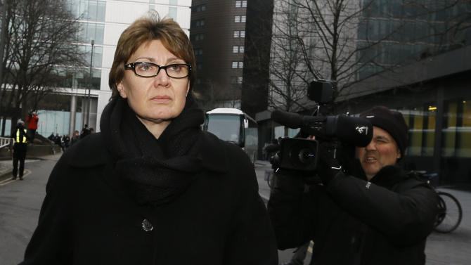 CORRECTS SPELLING OF SOUTHWARK   Detective Chief Inspector April Casburn of the London Metropolitan Police leaves Southwark Crown Court in London, Thursday, Jan. 10, 2013. Casburn has been found guilty of offering the now-defunct tabloid, The News of the World,  information about Operation Varec, the investigation into whether Scotland Yard's inquiry into phone hacking should be reopened. (AP Photo/Kirsty Wigglesworth)