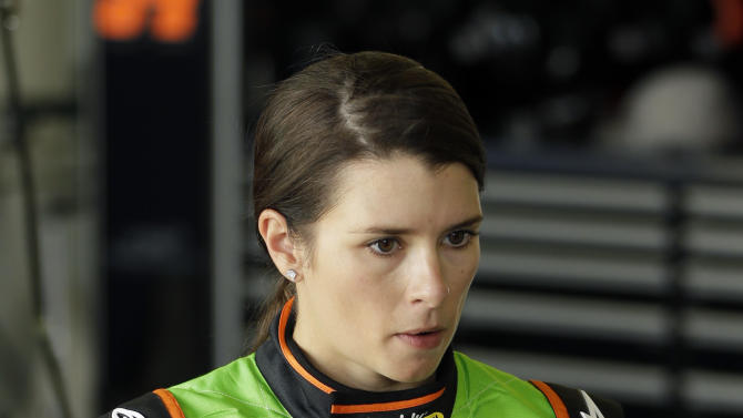 Driver Danica Patrick walks away from her car in her garage after she had engine problems and left the NASCAR Nationwide Series auto race at Daytona International Speedway, Saturday, Feb. 23, 2013, in Daytona Beach, Fla. (AP Photo/John Raoux)