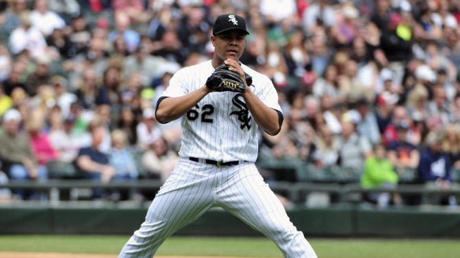 Chicago White Sox starting pitcher Jose Quintana reacts after giving up a single to Minnesota Twins' Torii Hunter during the fourth inning of a baseball game, Sunday, May 24, 2015, in Chicago. (AP Photo/David Banks)