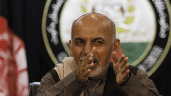 Ashraf Ghani, who is head of a commission overseeing the transition to Afghan-led security, gestures while announcing a list of areas where Afghan forces will take the lead from foreign troops during a press conference in Kabul, Afghanistan, Sunday, May 13, 2012. The Afghan government says it is taking the lead from the U.S.-led coalition for providing security in areas that will eventually make up 75 percent of the country's population. (AP Photo/Rahmat Gul)