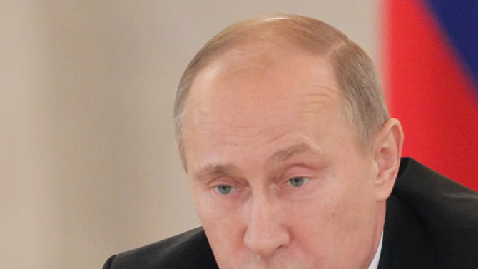 Russian President Vladimir Putin speaks during a meeting with members of the Presidential Human Rights Council in the Kremlin in Moscow, Russia, Monday, Nov. 12, 2012. (AP Photo/Yuri Kochetkov, Pool)