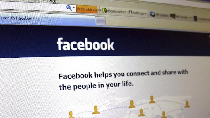 This June 20, 2012 photo shows a Facebook login page on a computer screen in Oakland, N.J. Facebook is expected to report their quarterly financial results after the market closes on Thursday, July 26, 2012. (AP Photo/Stace Maude)