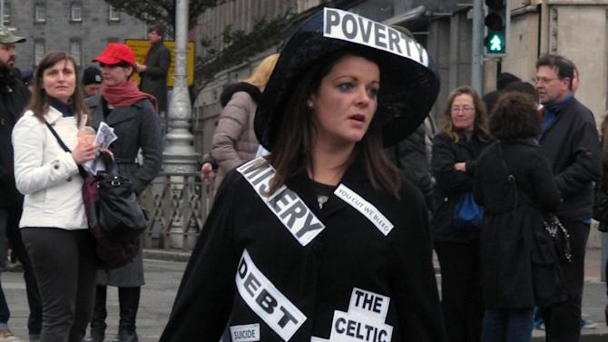 Dublin school assistant Lizzy Stringer,26, parades in a costume depicting Ireland's economic woes during an anti-austerity protest Saturday, Nov. 24, 2012. The government says it will unveil Ireland's sixth straight austerity budget next month in hopes of reducing the country's 2013 deficit to 8.6 percent, still nearly triple the spending limit that eurozone members are supposed to observe. (AP Photo/Shawn Pogatchnik)