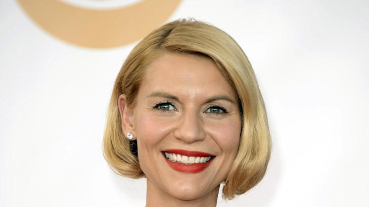 "FILe - This Sept. 22, 2013 file photo shows actress Claire Danes at the 65th Primetime Emmy Awards at Nokia Theatre in Los Angeles. Danes has been tapped to host the 20th anniversary Nobel Peace Prize concert in December. The Emmy-winning ""Homeland"" actress will host the Dec. 11 event in Oslo, Norway. (Photo by Dan Steinberg/Invision/AP, File)"
