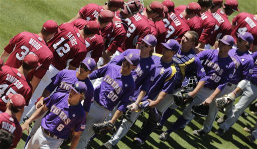 LSU players are congratulated by Arkansas players following a 3-1 win in their Southeastern Conference Tournament baseball game at the Hoover Met in Hoover, Ala., Saturday, May 25, 2013