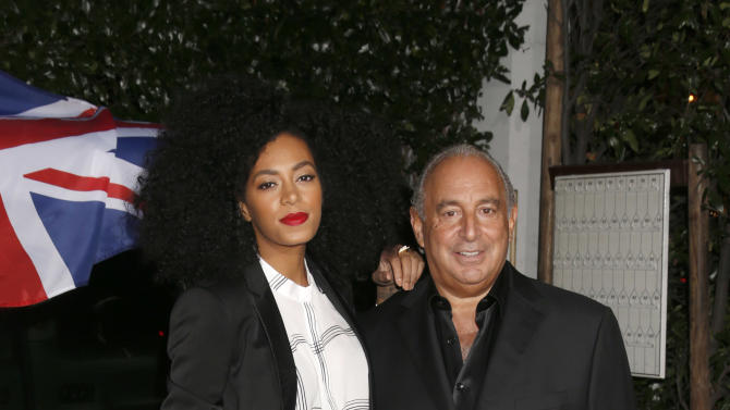 Solange Knowles and Sir Philip Green attend the Topshop Topman LA Opening Party At Cecconi's in Los Angeles, on Wednesday, Feb. 13, 2013 in Los Angeles. (Photo by Todd Williamson/Invision for/AP)