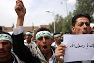 Yemeni men shout anti-American slogans during a demonstration in Sanaa. A Marine unit has been dispatched to protect the US embassy in Yemen, where police shot dead four protesters and wounded 34 others on Thursday as a mob breached its perimeter. There were more protests in Yemen on Monday