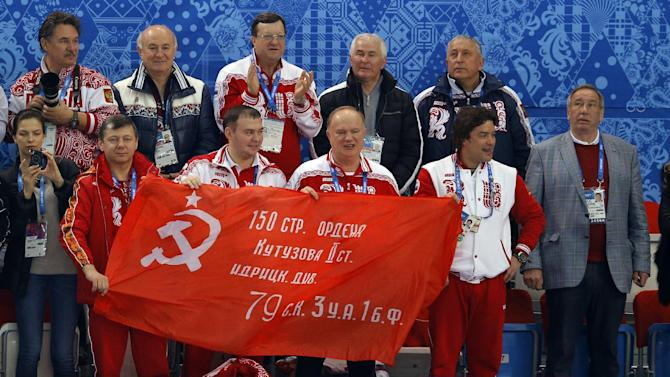 Communist party head shows banner at Sochi Games