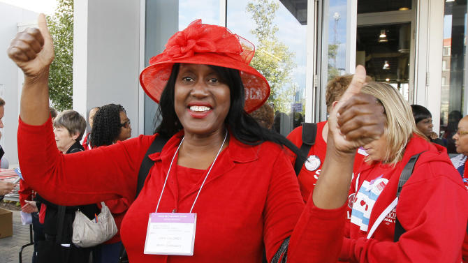 Mary Edmonds, a member of the Chicago Teachers Union's House of Delegates, celebrates after the delegates voted to suspend the strike against the school district Tuesday, Sept. 18, 2012, in Chicago. The city's teachers agreed to return to the classroom after more than a week on the picket lines, ending a spiteful stalemate with Mayor Rahm Emanuel that put teacher evaluations and job security at the center of a national debate about the future of public education. (AP Photo/Charles Rex Arbogast)