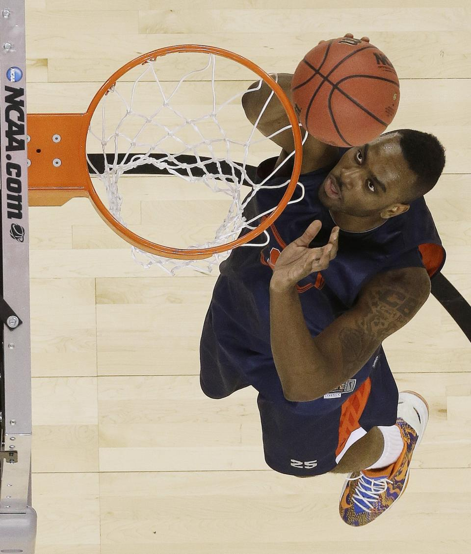Syracuse's Rakeem Christmas dunks the ball  during practice for their NCAA Final Four tournament college basketball semifinal game Michigan, Friday, April 5, 2013, in Atlanta. Wichita State plays Louisville in a semifinal game on Saturday. (AP Photo/Charlie Neibergall)