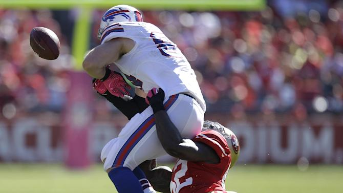 Buffalo Bills tight end Scott Chandler, left, fumbles the ball as he is tackled by San Francisco 49ers linebacker Patrick Willis during the second quarter of an NFL football game in San Francisco, Sunday, Oct. 7, 2012. San Francisco safety Dashon Goldson recovered the ball. (AP Photo/Ben Margot)