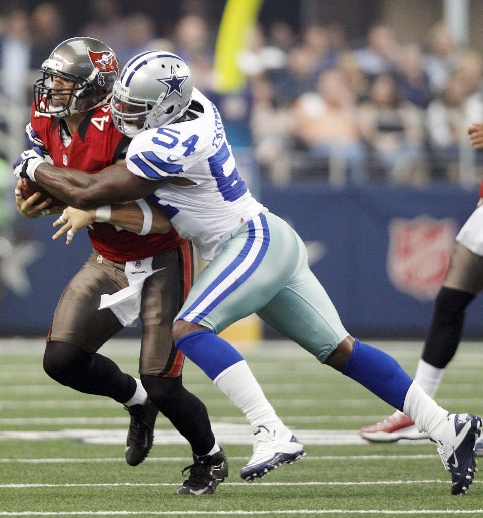 Dallas Cowboys inside linebacker Bruce Carter (54) tackles Tampa Bay Buccaneers tight end Dallas Clark (44) during the first half of an NFL football game on Sunday, Sept. 23, 2012, in Arlington, Texas. (AP Photo/LM Otero)