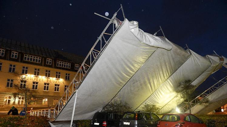 A a temporary marquee is blown over turned by heavy wind in Aabenraa, southern Jutland Denmark on Monday, Oct. 28, 2013. A major storm swept Denmark with winds peaking at up to 200 kph, (approx 125 mph). A savage coastal storm powered by hurricane-force gusts slashed its way through Britain and western Europe on Monday, felling trees, flooding lowlands and snarling traffic in the air, at sea and on land. At least 13 people were reported killed. It was one of the worst storms to hit the region in years. The deadly tempest had no formal name — and wasn't officially classified as a hurricane due to a meteorological standard — but it was dubbed the St. Jude storm (after the patron saint of lost causes) and stormageddon on social networks. (AP Photo/POLFOTO, Claus Bonnerup) DENMARK OUT