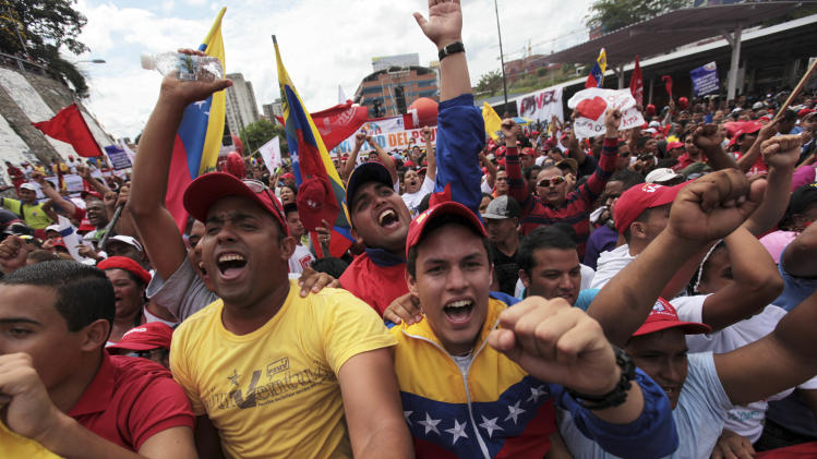 Supporters of Venezuela's President Hugo Chavez shout slogans during a rally in Caracas, Venezuela, Saturday March 10, 2012. Thousands held demonstrations on Saturday to show support for their ailing leader while he recovers from cancer surgery in Cuba. (AP Photo/Fernando Llano)