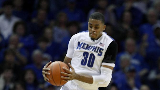 Memphis forward D.J. Stephens (30) tries to save a ball from going out-of-bounds against Louisville forward Chane Behanan (21) during the first half of an NCAA college basketball game on Saturday, Dec. 15, 2012, in Memphis, Tenn. (AP Photo/Lance Murphey)
