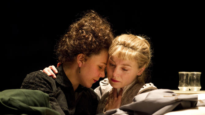 "In this theater publicity image released by The Publicity Office, Maggie Gyllenhaal, left, and Juliet Rylance, are shown in a scene from Anton Chekhov's ""Three Sisters,"" performing off-Broadway at Classic Stage Company in New York.  (AP Photo/The Publicity Office, Joan Marcus)"