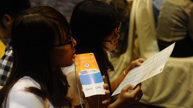 Vietnamese highschool students and their families attend an international education fair on October 26, 2014 in Hanoi