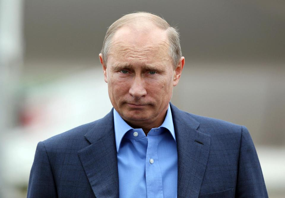 Russian President Vladimir Putin arrives at Belfast International Airport, in Northern Ireland, on Monday, June 17, 2013. President Hollande is in Northern Ireland to attend the G-8 Summit in Enniskillen. (AP Photo/ Peter Muhly, Pool)