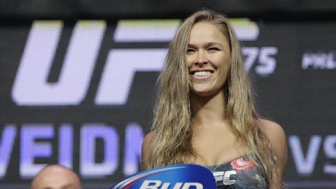 Ronda Rousey stands on the scale during a weigh-in for the UFC 175 mixed martial arts event at the Mandalay Bay, Friday, July 4, 2014, in Las Vegas. Rousey is scheduled fight Alexis Davis in a women's bantamweight title fight on Saturday in Las Vegas