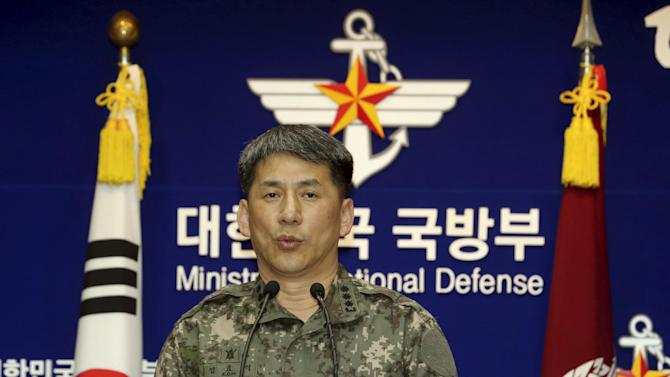 South Korean Army Col. Eom Hyo-sik gives a briefing on a North Korean navy ship which fired two artillery shells in the Yellow Sea, at the Defense Ministry in Seoul, South Korea, Thursday, May 22, 2014. North and South Korean warships exchanged artillery fire Thursday in disputed waters off the western coast, South Korean military officials said, in the latest sign of rising animosity between the bitter rivals in recent weeks. (AP Photo/Yonhap, Choi Jae-gu) KOREA OUT