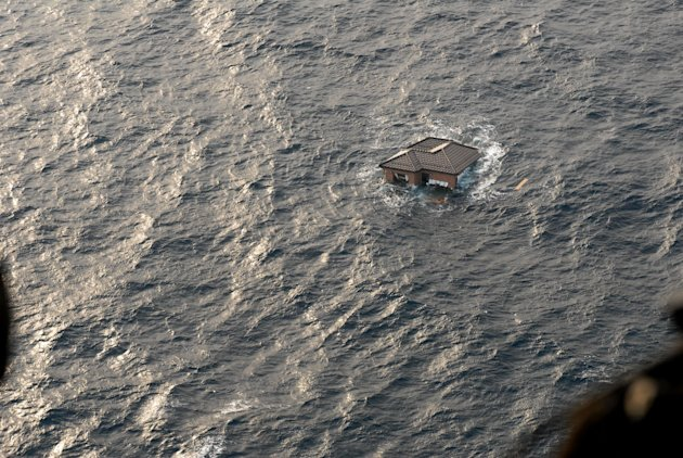 FILE - This file photo taken March 13, 2011, and provided by the U.S. Navy, shows a Japanese home adrift in the Pacific Ocean, days after a massive earthquake and the ensuing tsunami hit Japan's east