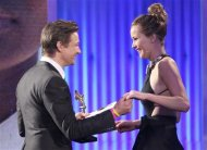 "Presenter Jeremy Renner congratulates actress Jennifer Lawrence as she accepts the best female lead award for ""Silver Linings Playbook'' at the 2013 Film Independent Spirit Awards in Santa Monica, California February 23, 2013. REUTERS/David McNew"