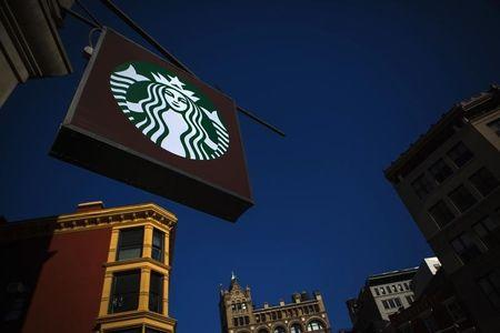 The sign of a Starbucks store is seen in New York