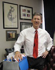 In this Friday Aug. 26, 2011 photo, Fresno County School Superintendent Larry Powell poses for a photo in his office, in Fresno, Calif. Powell is forgoing $800,000 in compensation over the next three years of his term. Until his term expires in 2015, Powell will run 325 schools and 35 school districts with 195,000 students, all for less than a starting California teacher earns. As he prepares for retirement, he wants to ensure that his pet projects survive California budget cuts. (AP Photo/Tracie Cone)