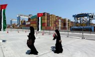 <p>Emirati women walk in the new Khalifa Port in Abu Dhabi on September 1, 2012. Oil-rich Abu Dhabi began commercial operations at its new Khalifa Port which has cost $7.2 billion.</p>